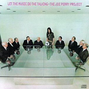You have to love this album cover: Perry takes a reel of tape to the record company. Says nothing. Looks moody.