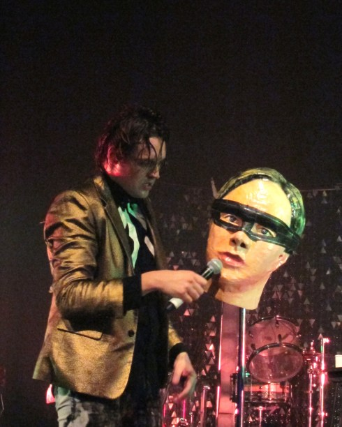 Win Butler and head Arcade Fire